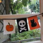 Guirlande de fanions halloween avec citrouille, tête de mort et chat